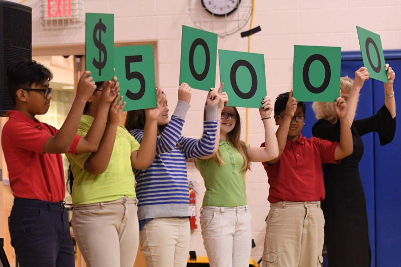 Perry Township Schools Students Hold Up Numbers Representing $50,000 Award
