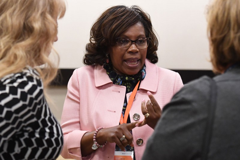 NIET Senior Program Specialist Theresa Hamilton Meets with Conference Participants