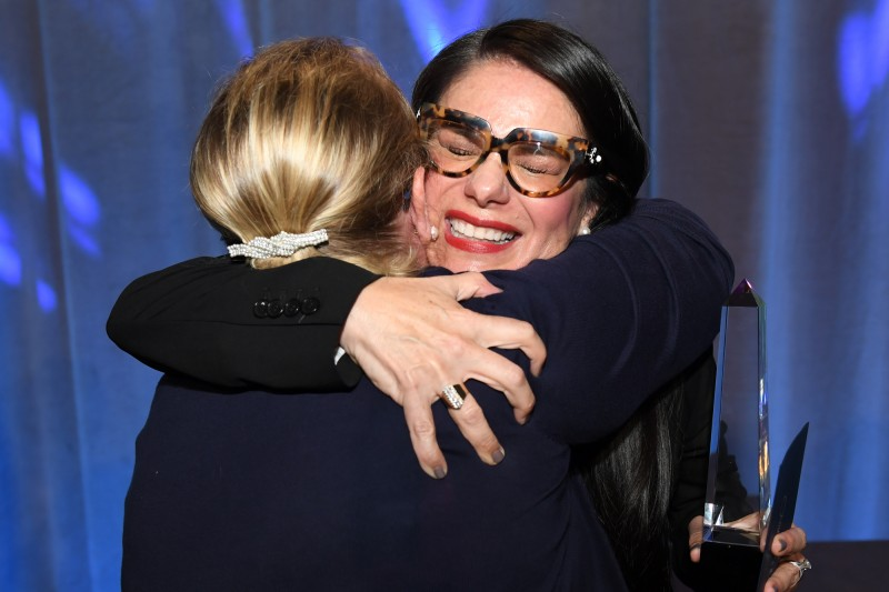 Araceli Montoya and Elzbieta Galek Share in a Congratulatory Hug
