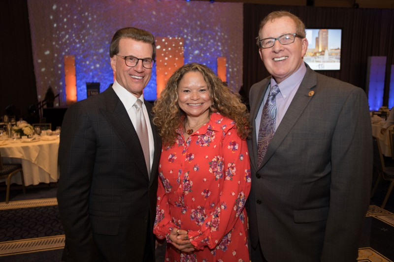 NIET Chairman Lowell Milken, Lowell Milken Center Fellow and Milken Educator Madeline Hanington, and Lowell Milken Center Executive Director Norm Conard